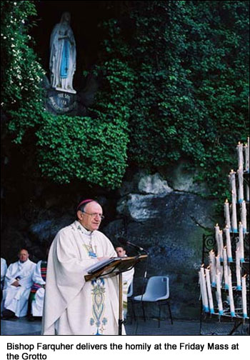 Bishop Farquher delivers the homily at the Friday Mass at the Grotto